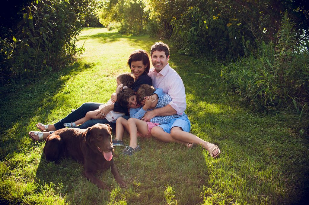 Family of five with dog outside for photos at sunset in Canton, OH.