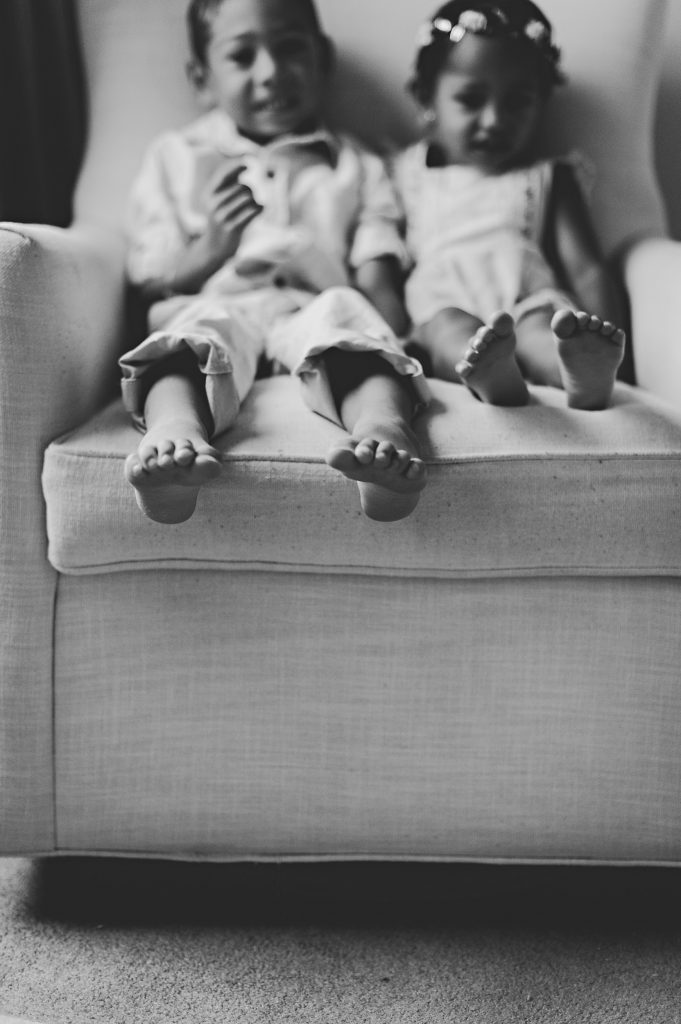 Black and white image of little kid's feet.