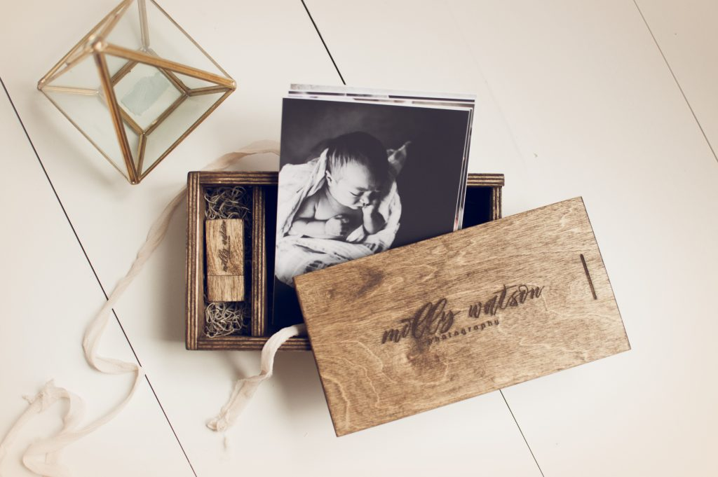 Engraved wood print box with black and white photos inside.