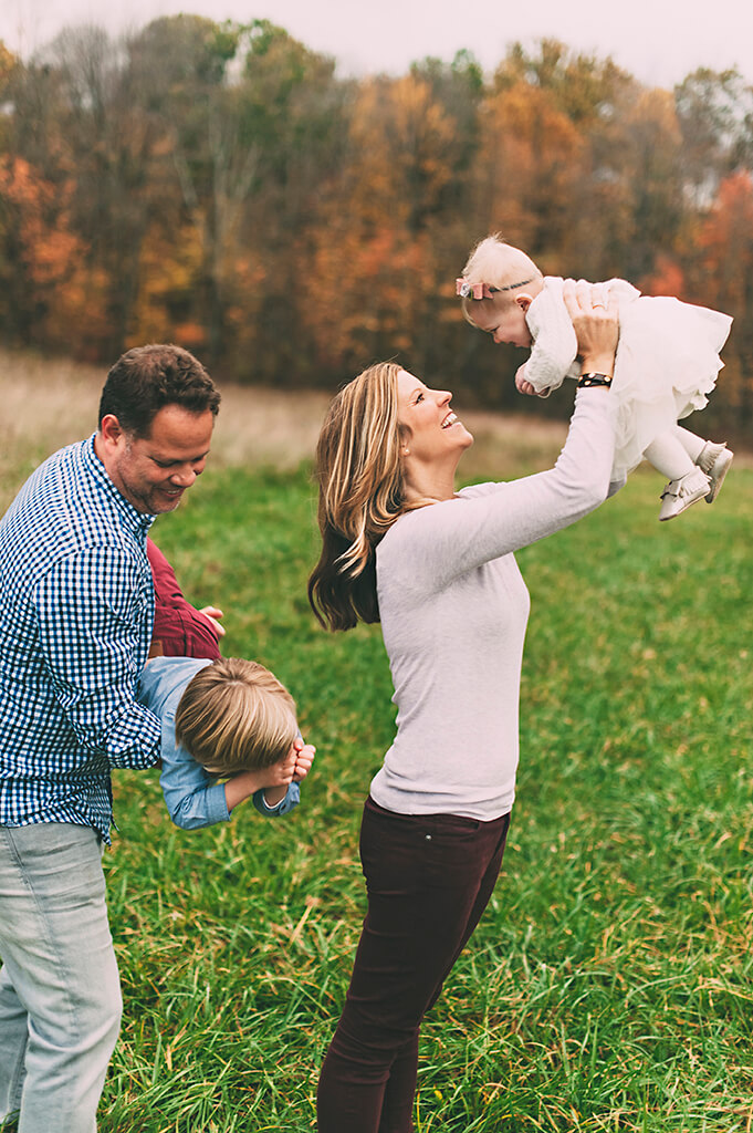 Family playing in a field outside of Cleveland for an evening family photos.