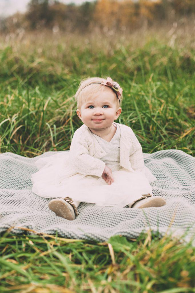 Little girl on blanket in a field near Cleveland.