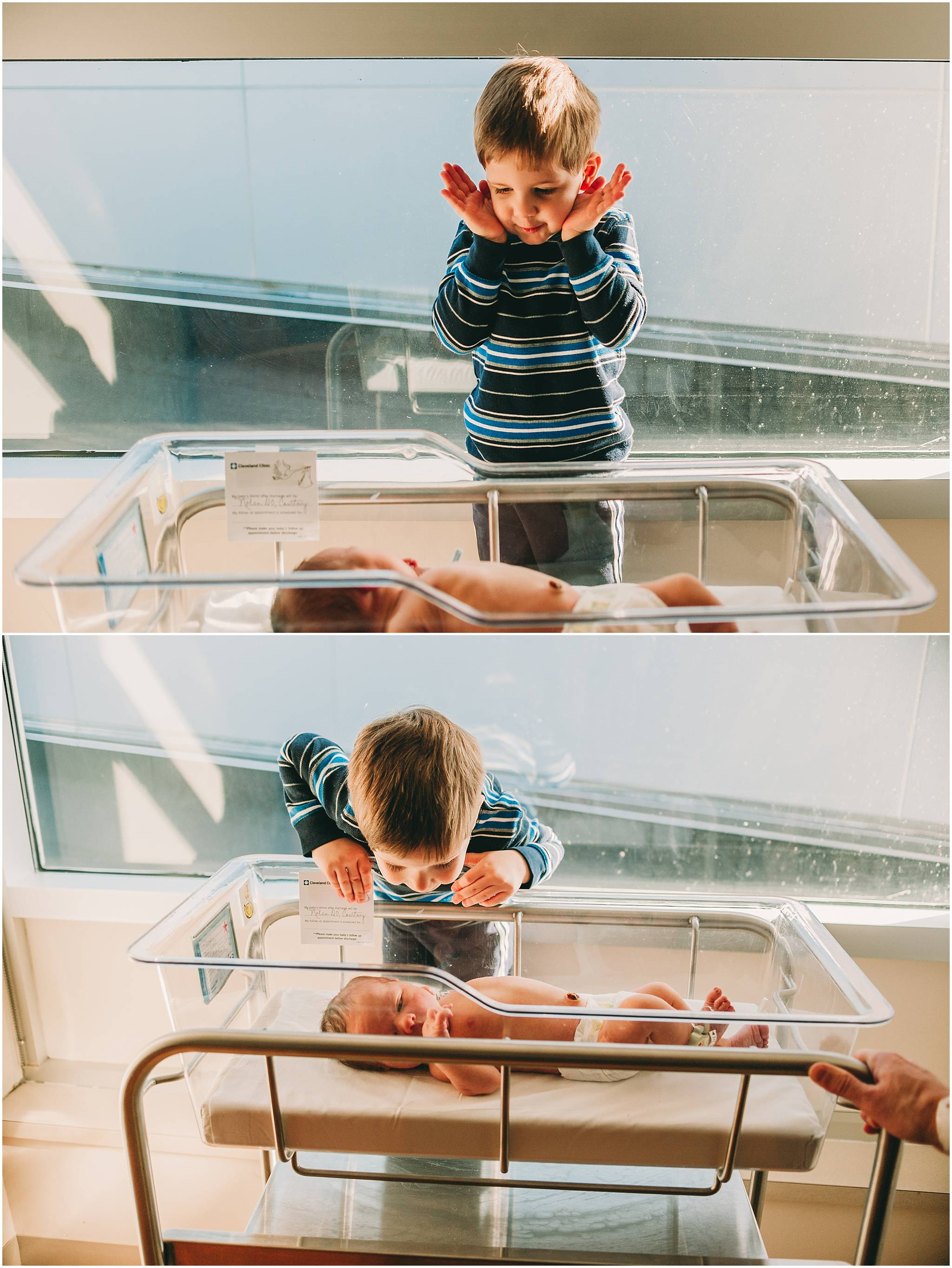 Big brother playing peek a book with newborn brother in Cleveland hospital