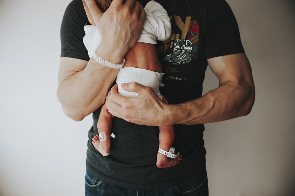 Detail image of Dad holding baby boy in Cleveland hospital.