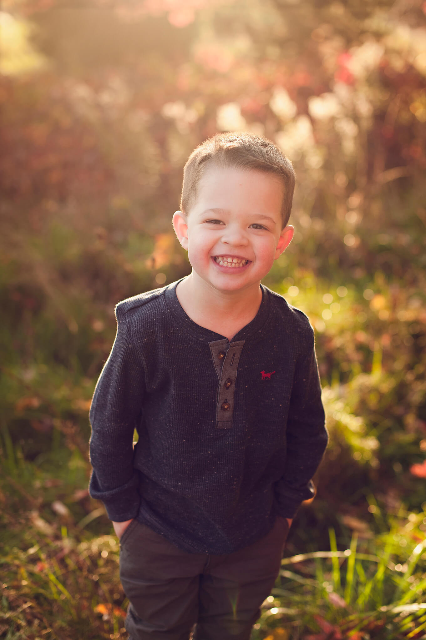 Little boy smiling for family portraits in Akron, OH.
