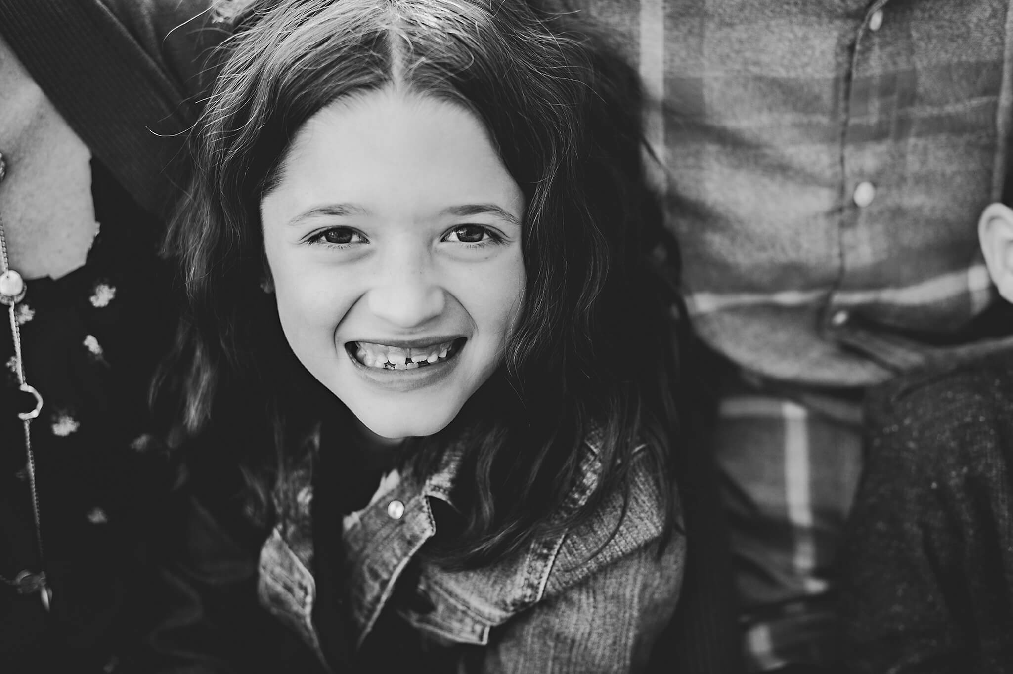 Little girl with big smile during family portraits.