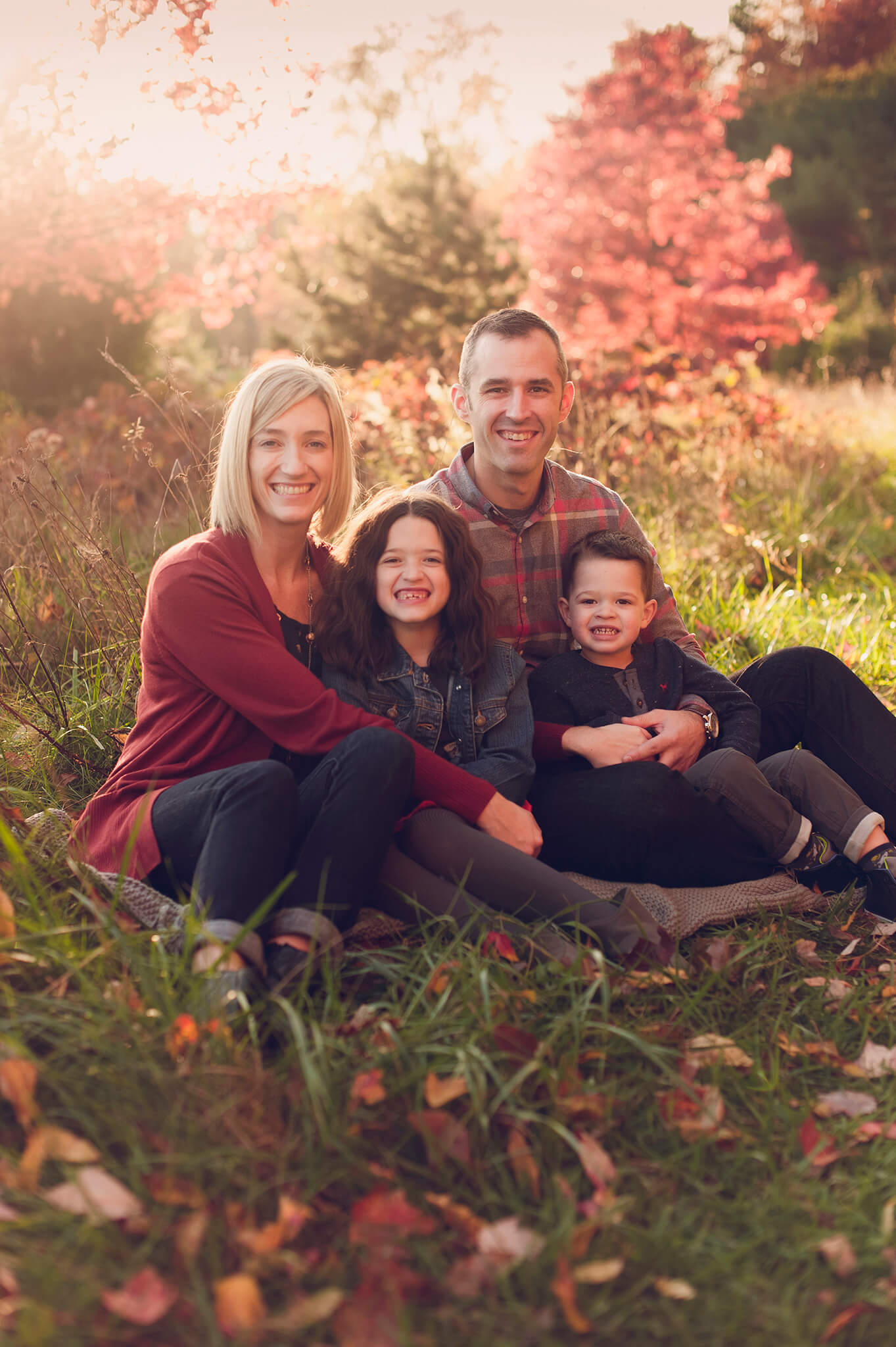 Family sitting for fall sunset family session in Akron.