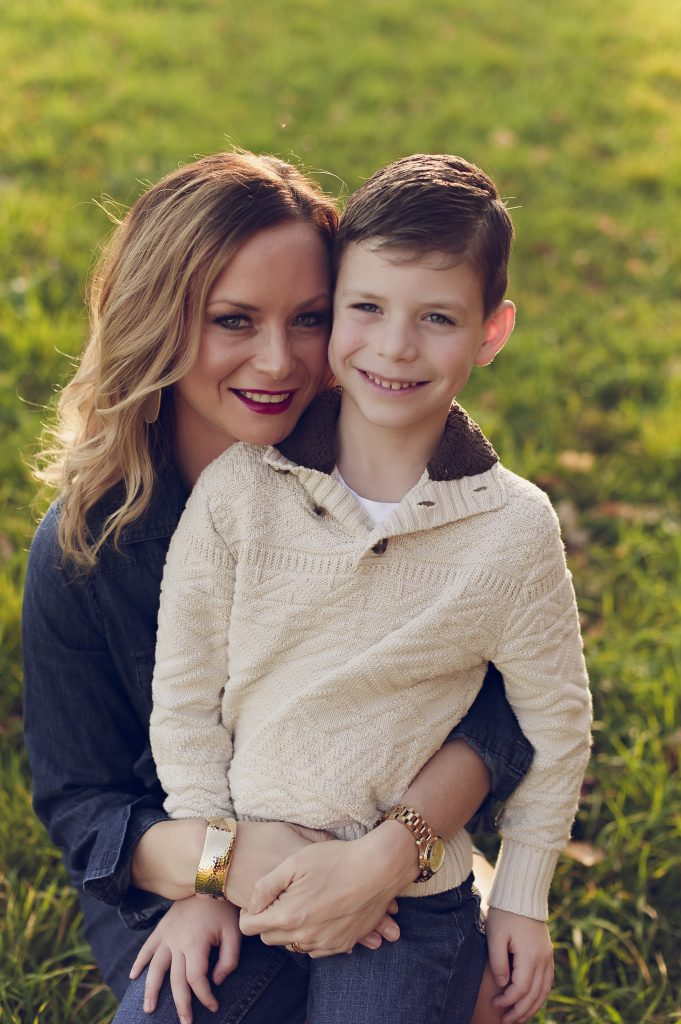Mom with young son at family outdoor photo session at sunset in Medina park.