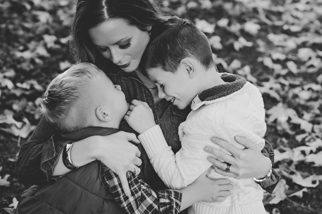Black and white image of Mom hugging two boys, photo taken by Cleveland Photographer Molly Watson.