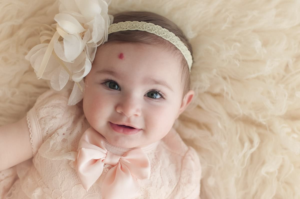 Beautiful baby girl with long lashes.