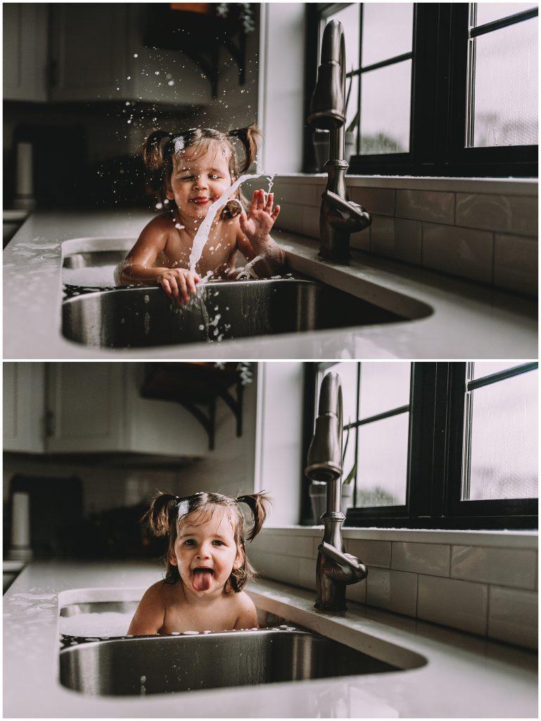 Baby splashing in sink bath.