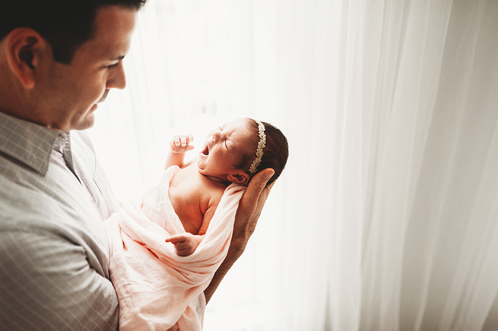 father holding baby girl in Medina photography studio session